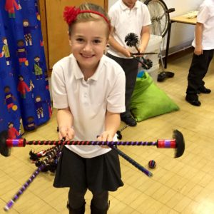 Learning to use a Flowerstick at a Circus Skills workshop in a school in Gloucester